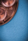 Vintage coppery tray and tea cups on blue table. Cloth Royalty Free Stock Photos