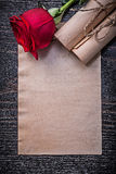 Vintage corded paper rolls red expanded rose on Royalty Free Stock Photo