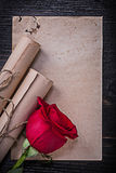 Vintage corded paper rolls red natural rose on Stock Photo