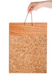 Vintage corkboard in hand Stock Image