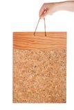 Vintage corkboard in hand Stock Image