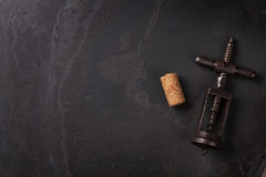 Vintage corkscrew and cork on stone table Royalty Free Stock Photo