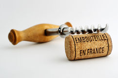 Vintage corkscrew and wine cork with inscription embouteille en Stock Photo