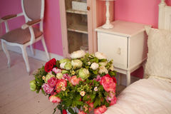 Vintage corner of the bedroom with flowers Royalty Free Stock Images