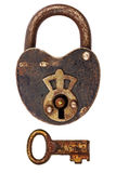 Vintage corroded padlock with key isolated on white Royalty Free Stock Photography