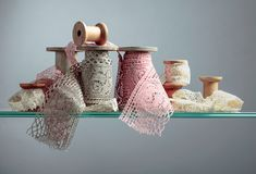 Vintage cotton lace trims on wooden spools. Free space for your text stock image
