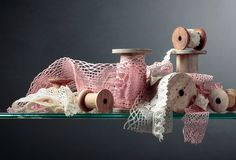 Vintage cotton lace trims on wooden spools. Free space for your text stock photography