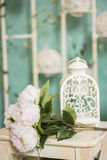 Vintage country house interior with a table with a vase and flovers stock photos