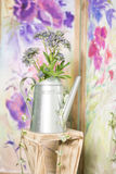 Vintage country house interior with a table with a vase and flovers royalty free stock photography