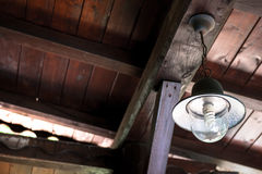 Vintage country lamp on wooden ceiling Stock Photos