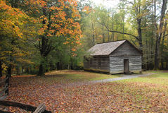 Vintage country one room school house. Vintage one room country school house in early fall season. Set in the woods and the mountains with school yard and split Royalty Free Stock Photography