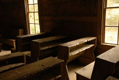 Vintage country school room. Vintage classroom desks inside a one room country school house. Looking from back to front Royalty Free Stock Photography
