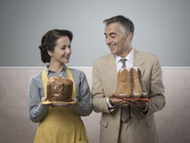 Vintage couple with cakes Stock Photos