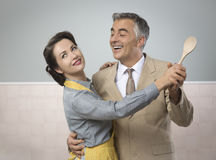 Vintage couple dancing in the kitchen Royalty Free Stock Photography