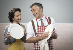 Vintage couple dish washing together Royalty Free Stock Photos