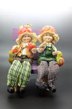 Vintage couple dolls sitting on chair Royalty Free Stock Photo