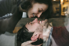 Vintage couple . Girl kiss her boyfriend from above .Coffee sho. Vintage couple hugs and laughing .Coffee shop. instagram toned royalty free stock image