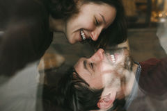 Vintage couple . Girl kiss her boyfriend from above .Coffee sho. Vintage couple hugs and laughing .Coffee shop. instagram toned royalty free stock photography