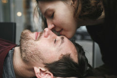 Vintage couple . Girl kiss her boyfriend from above  .Coffee sho Royalty Free Stock Image