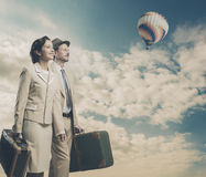 Vintage couple leaving for vacations Stock Images