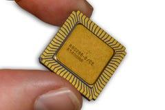 Vintage CPU between fingers Stock Photography