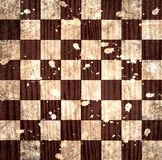 Vintage crack old scratched empty chess board. Royalty Free Stock Photos