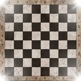 Vintage crack old scratched empty chess board. Stock Images