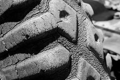 Vintage Cracked Rubber Tractor Tire. Black and white image of cracked rubber tractor tire Stock Images
