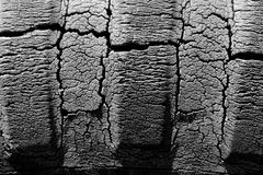 Vintage Cracked Rubber Tractor Tire. Black and white image of cracked rubber tractor tire Royalty Free Stock Photos