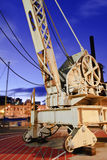 Vintage crane at dusk. Royalty Free Stock Photography