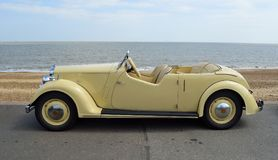 Vintage Cream Coloured Rover  Motor Car Parked on Seafront Promenade. Stock Image