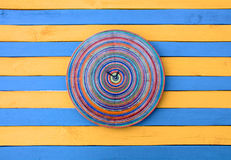 Vintage creative clock blue and yellow striped wood texture surface Royalty Free Stock Photography
