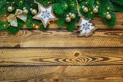 Vintage Cristmas decoration with fir branch over old wood. Flat lay, text space Stock Photography