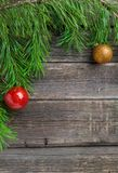 Vintage Cristmas decoration with fir branch over old wooden background. Flat lay, text space. Cristmas decoration with fir branch over old wooden background stock photos