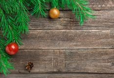 Vintage Cristmas decoration with fir branch over old wooden background. Flat lay, text space. Cristmas decoration with fir branch and pine over old wooden stock photography