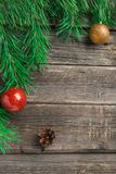 Vintage Cristmas decoration with fir branch over old wooden background. Flat lay, text space stock image