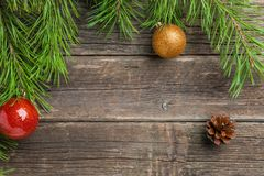 Vintage Cristmas decoration with fir branch over old wooden background. Flat lay, text space. Cristmas decoration with fir branch and pine over old wooden royalty free stock images