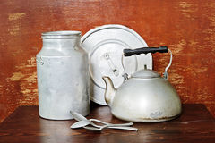 Vintage crockery. Vintage cooking crockery - kettle, milk can and other Stock Image
