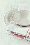 Vintage crockery and tea towels Stock Photography