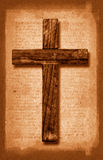Vintage Cross. A vintage paper texture with a wooden cross stock photos