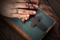 Vintage cross on Bible Royalty Free Stock Photos