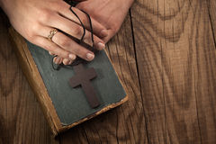 Vintage cross on Bible Stock Photos