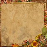 Vintage crumpled paper with autumn decorations Royalty Free Stock Image