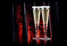 Vintage crystal champagne flutes on a black classy velour background. The Crystal glass is a designer flutes art-deco Royalty Free Stock Images