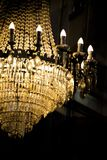 Vintage crystal chandelier luxury light as part of rich glamour Stock Photography