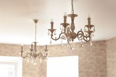 Vintage crystal glass chandelier with led lamps in living room stock images