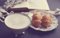 Vintage cup of cappuccino and croissants Stock Photography