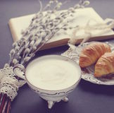 Vintage cup of cappuccino and croissants Royalty Free Stock Photo