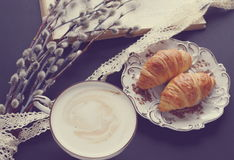 Vintage cup of cappuccino and croissants Royalty Free Stock Images