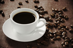 Vintage cup of coffee and beans Royalty Free Stock Photos